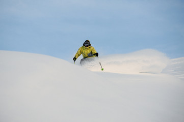 Professional snowboarder sliding down the snowy slope