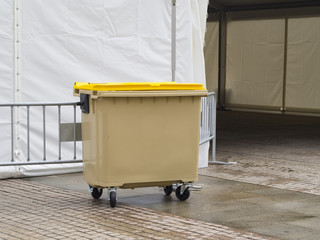 Plastic garbace container in the street