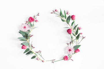 Flowers composition. Wreath made of various pink flowers and eucalyptus branches on white background. Flat lay, top view, copy space