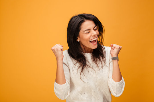 Portrait of an excited young woman celebrating success