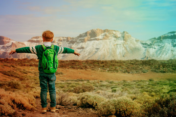 little boy hiking travel in mountains