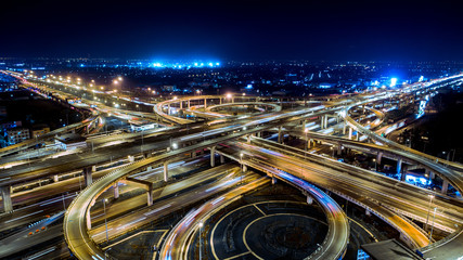 In de dag Nacht snelweg The highway in the big city, expressway enter the city, blue light picture by drone on top view.