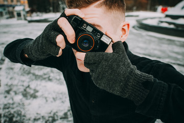 portrait of stylish handsome man with camera