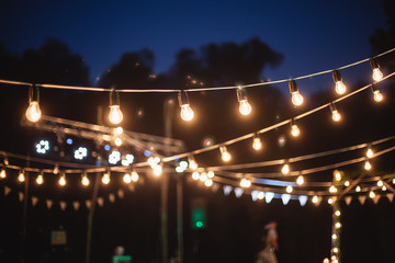 A garland of light bulbs in the decoration of the night ceremony