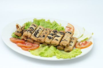 Fish roll in plate isolated on white