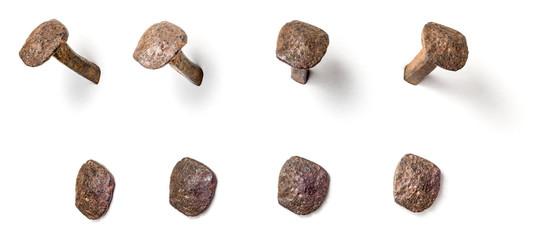 Freigestellter handgeschmiedeter Nagel aus unterschiedlichen Perspektiven