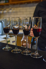 Wine pouring into the glasses on bar