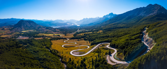 Aerial panorama of the curved asphalt road trough mountains. Carretera Austral road near the Cerro Castillo National Park. Chile