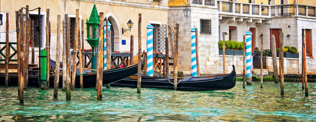 Wall Mural - Gondolas and wooden piles on the grand Canal, panorama of Venice, Italy
