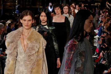 Models present creations by British designer Stella McCartney during her Autumn/Winter 2018-2019 women's ready-to-wear collection show, during Fashion Week in Paris