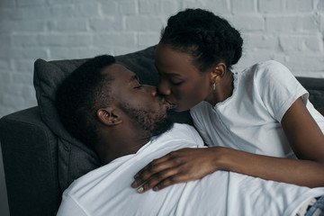 beautiful happy young african american couple kissing at home