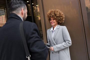Cheerful stylish woman looking at man