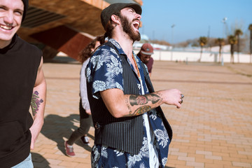 Cheerful cool man dancing on street
