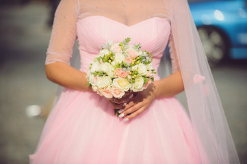 Bride in Pink Dress with Bouquet