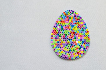 Easter egg from color thermoplastics. The photo contains a place for text.