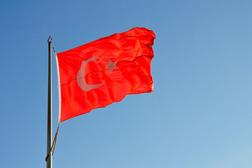 The flag of Turkey on the flagpole in the sky
