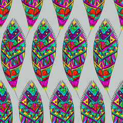 Fashionable bright seamless pattern with ornamental feathers. Vector tribal style pattern.