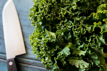 Close Up Of Fresh Kale On Table With Knife
