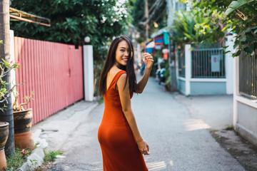 Cheerful woman posing on street