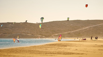 Windsurfers and kitesurfers riding at the Prasonisi beach at Rhodes island