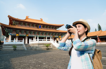Asian young woman taking the photo