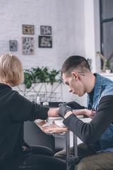 Girl in tattoo studio with artist working