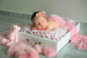 Stock photo of beautiful newborn baby sleeping in cute props