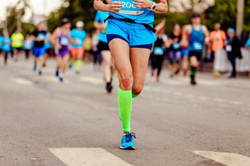 Wall Mural - female runner athlete run ahead of group runners