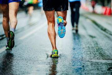 Wall Mural - water sprays from under running shoes runner men