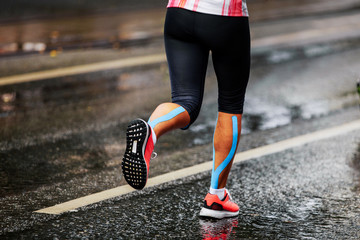 Fototapete - blue kinesio tape on calf muscle women runner