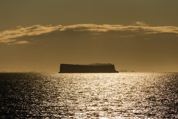 Tabular iceberg at sunset