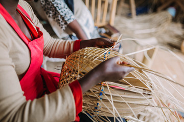 woman weaving basked out of bamboo in Rwanda Africa