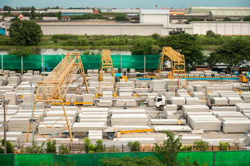 Manufacturer of precast concrete being processing transfer materials in storage yard area