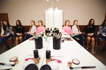 School of makeup. Students of a professional make-up artist in class