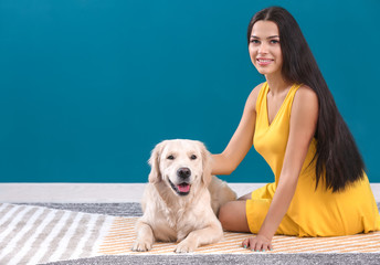 Young woman with dog indoors. Friendship between pet and owner