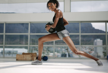 Fitness woman working out with medicine ball