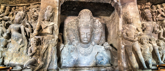 Wall Mural - Trimurti Sadashiva sculpture in the cave 1 on Elephanta Island. Mumbai, India