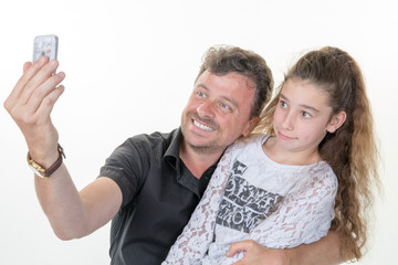 single father and young daughter selfie with smartphone