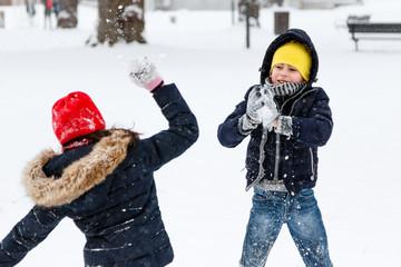 boy girl snowball fight
