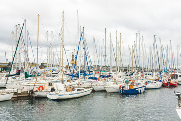 Variety of yachts and boats moored in harbour of port city of Saint-Malo, Brittany, France