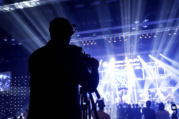 tv camera in a concert hall. Silhouette photos of the camera workers at the party.