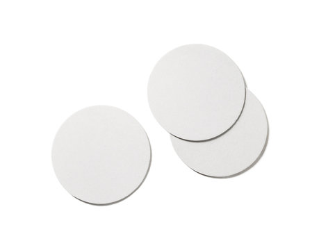 Photo of blank beer coasters on white background. Isolated with clipping path. Flat lay.