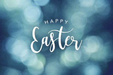 Happy Easter Calligraphy Text Over Blue Bokeh Lights Background