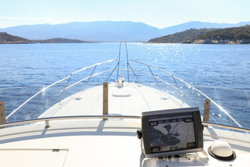 Summer day traveling by the yacht from Athens to Poros island, Greece.