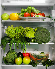 Refrigerator full of green nutritious food, vegetables and salad