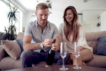 Loving couple drinking wine in their home.