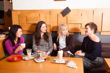 Informal meeting friends in cafe