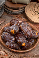 Traditional Middle East dessert, healthy food, big medjool dates fruits.
