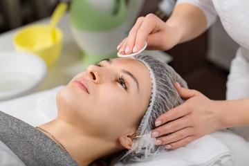 Young beautiful woman receiving facial massage