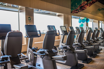 cycle machines in a gym with beautiful light from the window treadmill